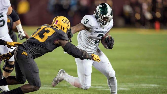 Michigan State running back LJ Scott (3) rushes around the edge past Minnesota linebacker Jonathan Celestin (13) in the second half of MSU's 30-27 win on Saturday, Oct. 14, 2017, in Minneapolis.