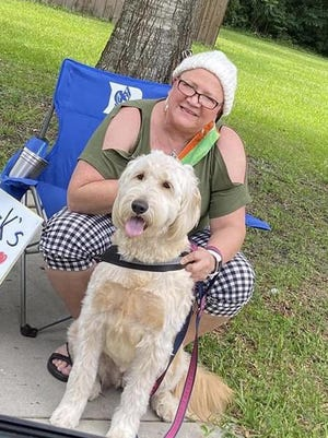 Pastor Sue Corley and Riley enjoy the special parade that St. Mark's United Methodist Church staged on June 14.