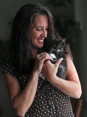 Kasey Spalding holds her kitten Doula, which was given