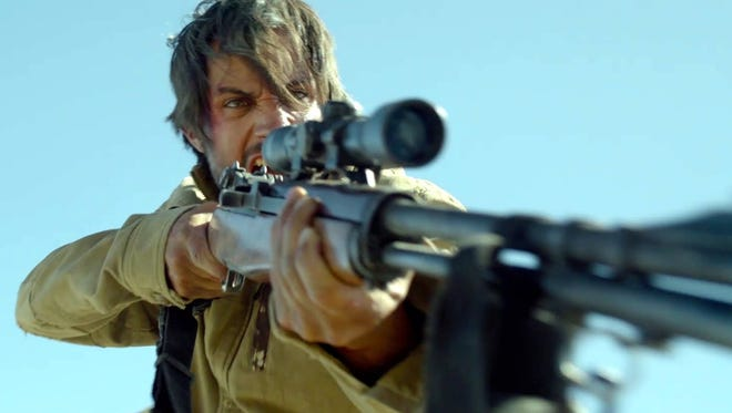"Moises (Gael Garcia Bernal) fights back in the thriller ""Desierto."""