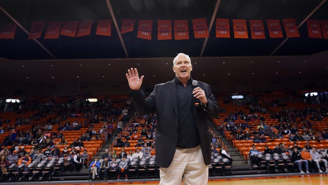 UTEP head football coach Dana Dimel introduces himself to basketball fans Saturday.
