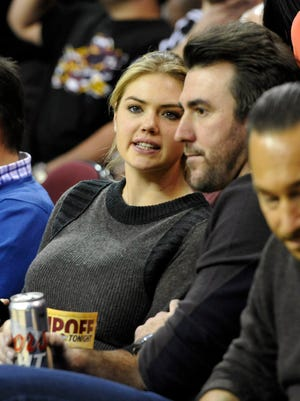 Dec 2, 2014; Actress and model Kate Upton (left) and Detroit Tigers pitcher Justin Verlander sit in the front row during a game between the Cleveland Cavaliers and the Milwaukee Bucks at Quicken Loans Arena.