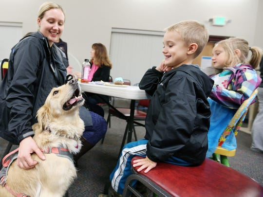 Nicole Rae of Independence brings her children, Bryson, 4, and Brooklynn, 6, and their dog, Molly, to the Willamette Humane Society's 50th anniversary celebration Saturday, Nov. 7, 2015. The event included face painting, games, crafts, shelter tours and more.