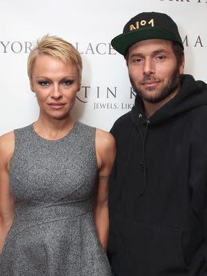 Pamela Anderson and Rick Salomon attend The Martin Katz Jewel Suite Debuts At The New York Palace Hotel on November 13, 2013 in New York City.