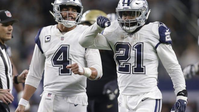 Nov 29, 2018; Arlington, TX, USA; Dallas Cowboys running back Ezekiel Elliott (21) celebrates after a first down with quarterback Dak Prescott (4) in the fourth quarter at AT&T Stadium. Mandatory Credit: Tim Heitman-USA TODAY Sports