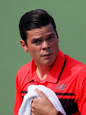 Milos Raonic (CAN) looks on against Feliciano Lopez