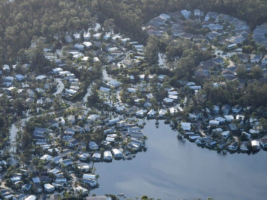 Water surrounds many of the homes in the Corkscrew Woodlands development in Estero, FL after Hurricane Irma.  Mandatory Credit: Craig Bailey/FLORIDA TODAY via USA TODAY NETWORK