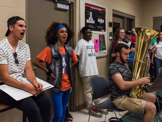 "Jermaine Nance rehearses songs with other members of the ensemble and the band as they prepare for the upcoming Public Education Foundation and Evansville Vanderburgh School Corporation summer musical ""Throughly Modern Millie"" at the Southern Indiana Career and Technical Center in Evansville, Ind., on Tuesday, June 20, 2017. The musical opens at 7 p.m. July 13 at Aiken Theatre in the Old National Events Plaza and runs through July 16."