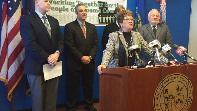 Broome County Executive Debbie Preston outlines highlights of the county's 2016 budget during a news conference Friday. With her are, from left, legislators Dan J. Reynolds, Steve Flagg, Karl Bernhardsen and Jerry Marinich.