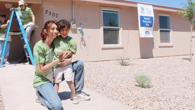 Roxanne Garcia embraces her daughter Allianna Gutierrez in front of their new home. On Saturday, women from all over the community volunteered with White Sands Habitat for Humanity to work on the house as part of the 2016 National Women Build event.