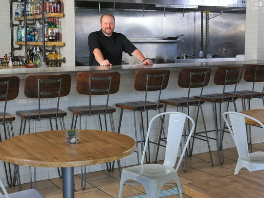The Fat Lamb has an open kitchen where diners can watch the chefs in action. Pictured here, Dallas McGarity, chef and owner