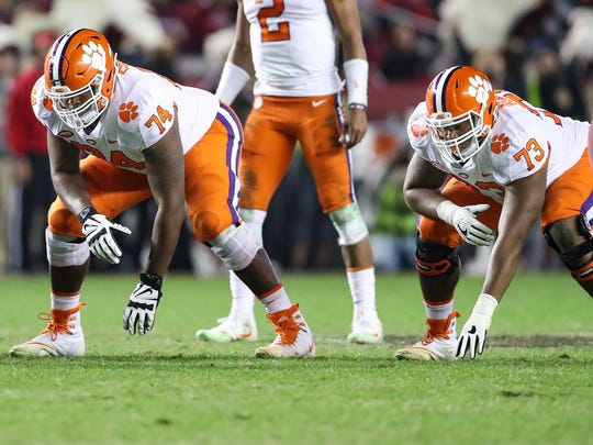 Nov 25, 2017; Columbia, SC, USA; Clemson Tigers guard John Simpson (74) and offensive tackle Tremayne Anchrum (73) line up against the South Carolina Gamecocks during the second half at Williams-Brice Stadium. Mandatory Credit: Jim Dedmon-USA TODAY Sports