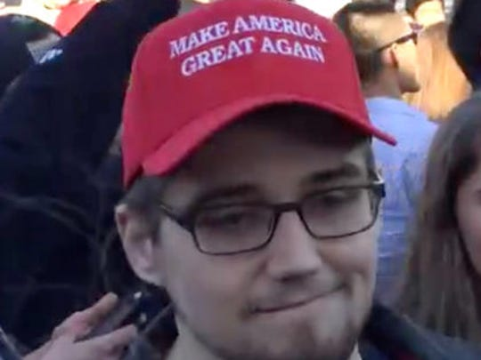 This Tuesday, March 29, 2016, image made from a video provided by Derek Hauger shows an unidentified man who police say pepper-sprayed a 15-year-old girl. Police are looking for the unidentified man. The opponents and supporters of Republican presidential front-runner Donald Trump clashed outside a rally Tuesday in Janesville, Wis.
