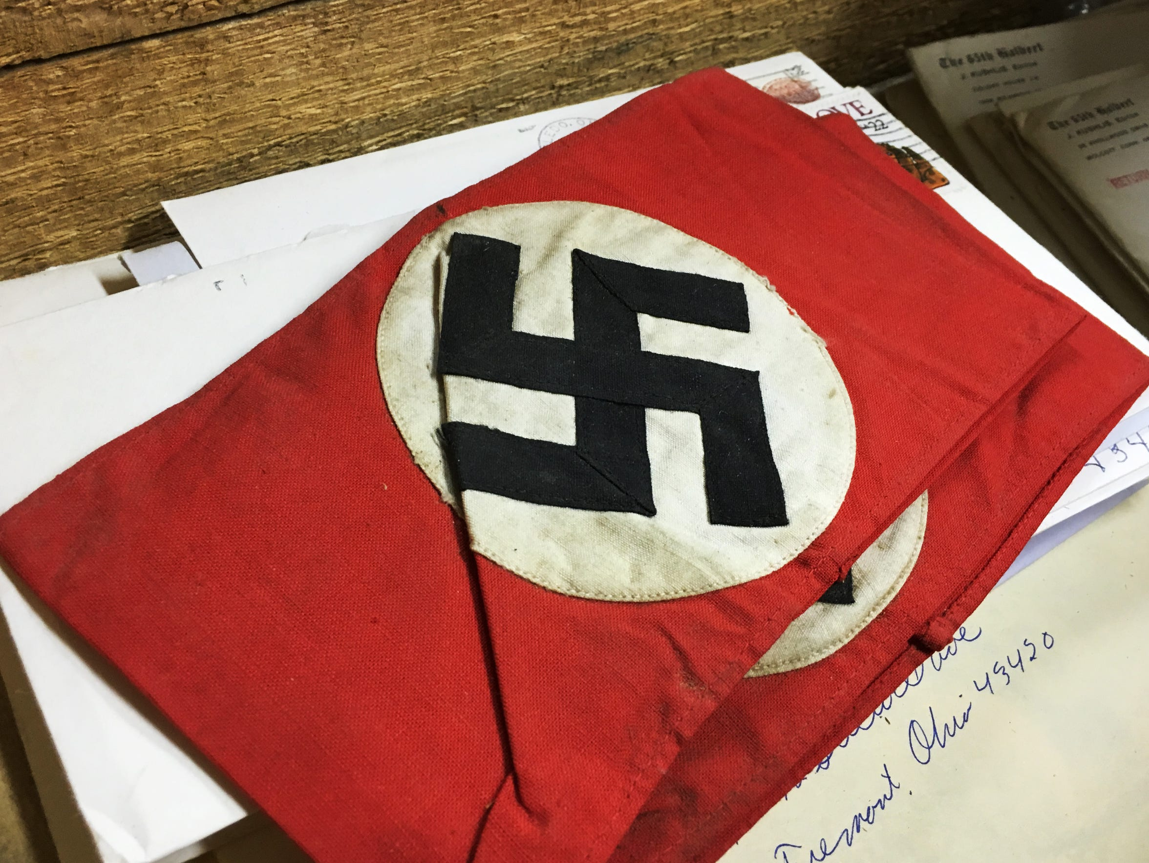 Robert Parman took a Nazi armbands from a German home