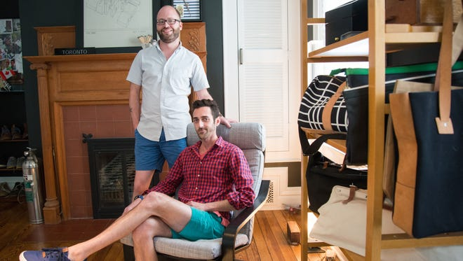 Barrett Evans and Kevin DiNarda pose in an expanded closet room inside their Westwood home.