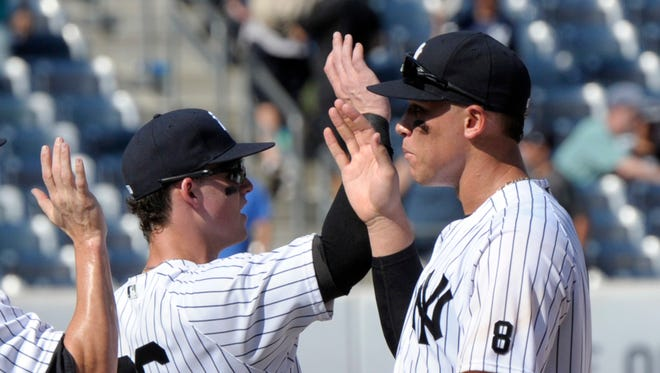 New York Yankees' Tyler Austin, left, and Aaron Judge celebrate after the Yankees defeated the Tampa Bay Rays, 8-4, in a baseball game Saturday, Aug. 13, 2016, at Yankee Stadium in New York.