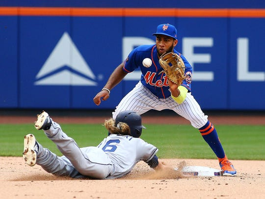 San Diego Padres right fielder Travis Jankowski (16) is out at second base after being picked off first base against the New York Mets during the fifth inning at Citi Field.
