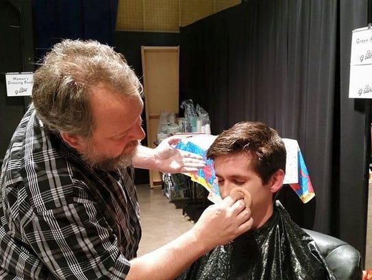 Chinook Winds clarinetist Chris Mothersole gets makeup