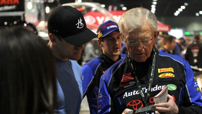 Joe Gibbs, right, chats with NASCAR driver Carl Edwards at a Supercross event at the Georgia Dome. Gibbs' youngest son Coy runs JGRMX, which fields three riders.