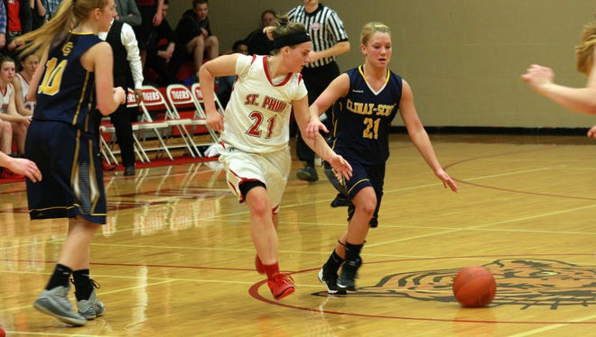 Climax-Scotts senior Madison Nabozny brings the ball up court with pressure from St. Philip junior Nina Winkler.