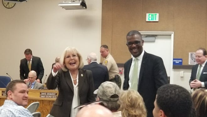 Troy Brown, right, stands with Moorpark Mayor Janice Parvin on Wednesday night. Brown was appointed Moorpark new city manager.