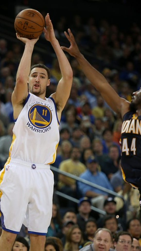"""Golden State Warriors' Klay Thompson (11) shoots over"
