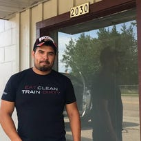 Juan Vidal stands outside the building at 2030 Chestnut St. that soon will house his new business, Rapids Barbell.