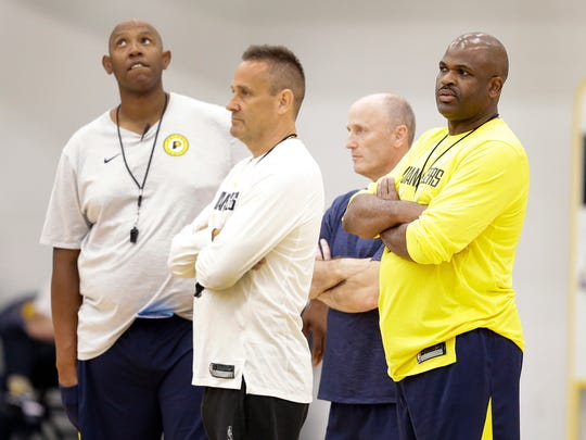 Indiana Pacers head coach Nate McMillan,right, along