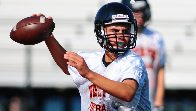 West De Pere High School quarterback Beau Mommaerts throws the ball during practice.