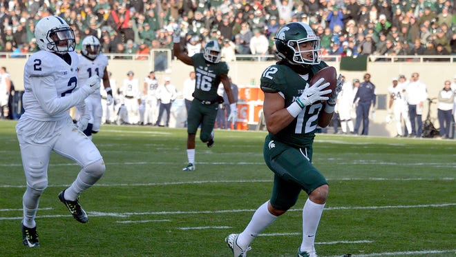 R.J. Shelton makes a TD catch during MSU's 55-16 win over Penn State last season, clinching a spot in the Big Ten championship game. Shelton returns to the Spartans this season.