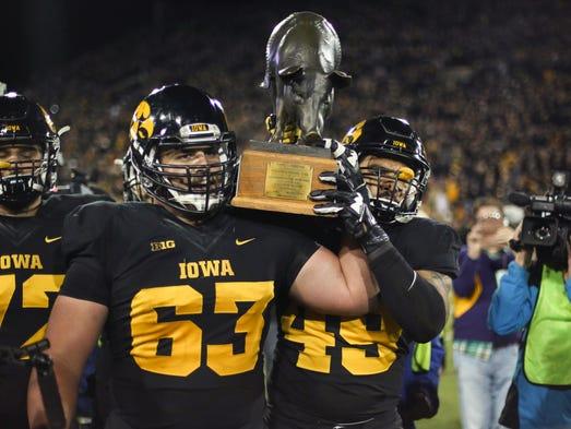 Iowa seniors Austin Blythe, left, and Melvin Spears