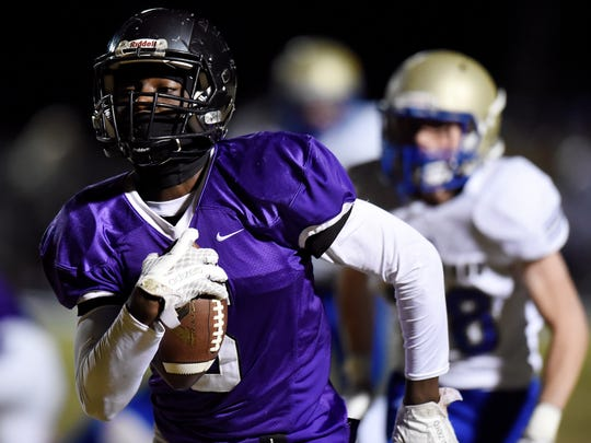 Cane Ridge running back Devon Starling (5) runs to the end zone for a touchdown against Brentwood during the first half of an high school football game Friday, Nov. 10, 2017, in Antioch, Tenn.