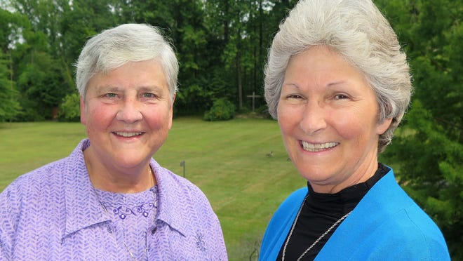 The Benedictine Sisters of Erie installed Sister Stephanie Schmidt, left, as the community's 22nd prioress on Aug. 15 during evening praise at their 84-member monastery in Harborcreek Township. She was elected to a five-year term and succeeds Sister Anne Wambach, right, who had served as prioress since 2010.
