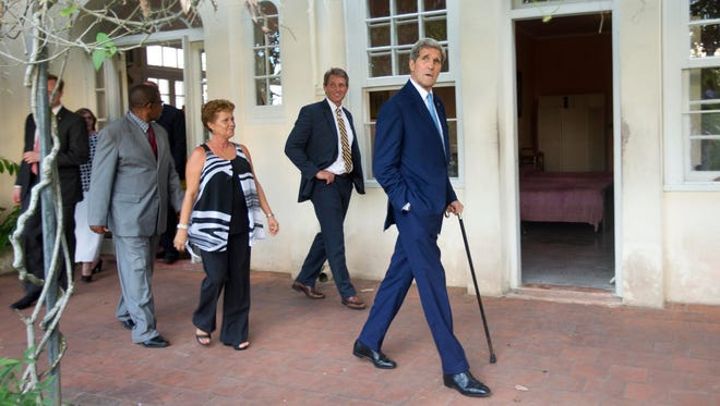 Sen. Jeff Flake, R-Ariz. (center) walks with Secretary of State John Kerry (right) during their tour of Finca Vigia, the former home of late U.S. writer Ernest Hemingway, now a museum, in Havana, on Aug. 14, 2015. Flake has been leading efforts in Congress to repeal or weaken the U.S. economic embargo on Cuba.