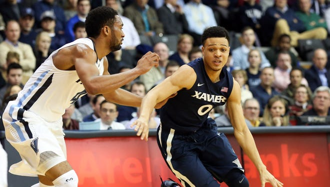 Xavier Musketeers guard Larry Austin Jr. (0) dribbles as Villanova Wildcats guard Darrun Hilliard II (4) defends during the first half at The Pavilion.