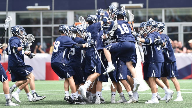 The Yale Bulldogs celebrate their victory over the Albany Great Danes at Gillette Stadium.