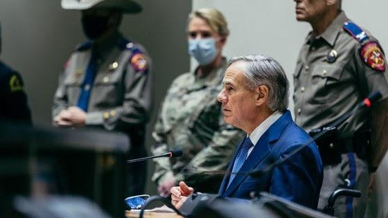 Gov. Greg Abbott is pictured at the press conference.