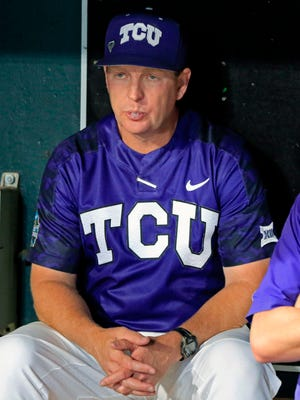 FILE - In this June 24, 2017, file photo, TCU head coach Jim Schlossnagle watches from the dugout after losing to Florida in an NCAA College World Series baseball elimination game in Omaha, Neb. TCU entered the season looking for a fifth straight trip to the College World Series. With a month left in the regular season, the Horned Frogs look like they might not even make the NCAA Tournament. (AP Photo/Nati Harnik, File)