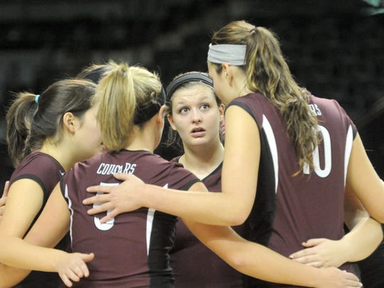 Stuarts Draft's Danielle Wilson looks to a teammate before the start of game five of a Group A, Div 2 Semifinal volleyball match played in Richmond on Friday, Nov. 16, 2012. Stuarts Draft defeated Giles High School after five games and advanced to the finals.