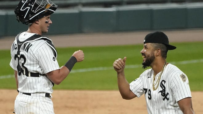 Chicago White Sox's Jose Abreu, right, celebrates with catcher James McCann after the White Sox defeated the Chicago Cubs over the weekend in Chicago. The Sox open the AL postseason Tuesday against the Oakland Athletics.