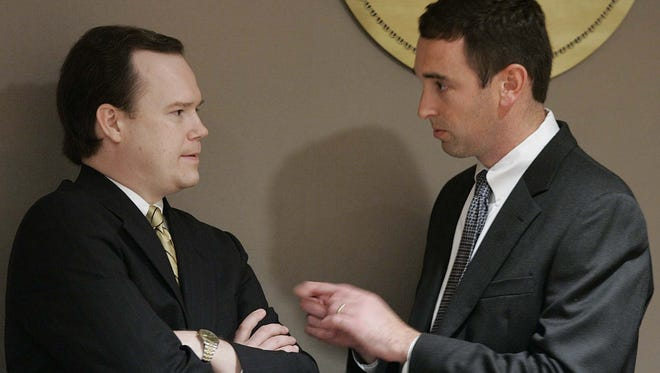 Greenville County Councilman Jim Burns, right, talks with former Councilman Scott Case in January 2005 just as Burns had arrived on the Council.
