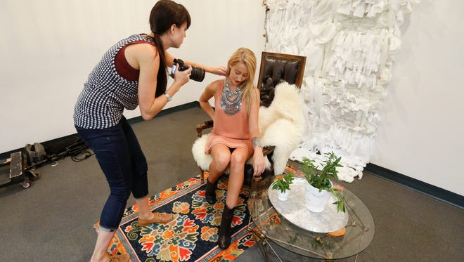 Stylist Shailey Murphy photographs model London Clift inside of her design for the upcoming 99x: Bohemian Belle fundraising event at the Springfield Art Museum.