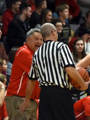 Rosecrans coach Todd Rock talks basketball with an official last season against Coshocton. Rock is back for his 24th season as Bishops head coach.