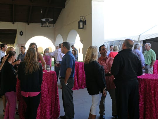 "Guests enjoy cocktail hour at Sept. 17's ""Pink Party & Press Conference"" held at D'Arrigo Brothers headquarters in Salinas. The event commemorated a 15-year combined effort in the fight against breast cancer."