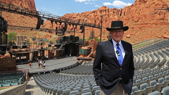 "Hyrum Smith, who financed the construction of Tuacahn, stands in the Ivins City amphitheater on May 31, 2017, with the set of Disney's ""Newsies"" in the background."