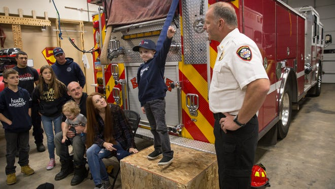 Farmington Fire Chief Terry Page names Kaj Shrode an honorary fire chief Friday during a ceremony at Farmington Fire Department Station 5.