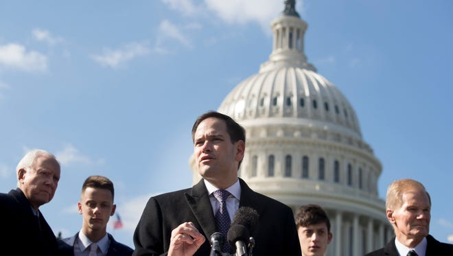 Republican Senator from Florida, Marco Rubio (C) speaks during a news conference held to introduce the 'Students, Teachers, and Officers Preventing (STOP) School Violence Act of 2018', on Capitol Hill in Washington, DC, USA, 13 March 2018.