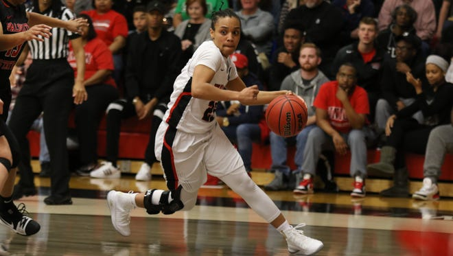 Union's Chelsey Shumpert dribbles the basketball during a game.