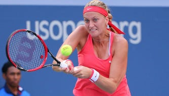 In a file photo from Sept. 9, 2015, Petra Kvitova  returns a shot to Flavia Pennetta of Italy during the U.S. Open.