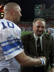 Bill Keenist congratulates QB Charlie Batch after the Lions win over the Bucs in Tampa, Fla. on Oct. 19, 2000.